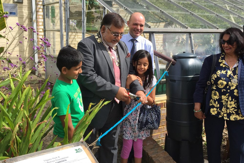 The mayor of Crawley offically declares the glasshouse open, watched by Andrew Short